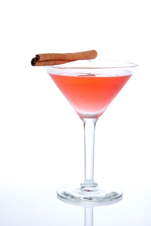 Cosmopolitan cocktail with cinnamon stick