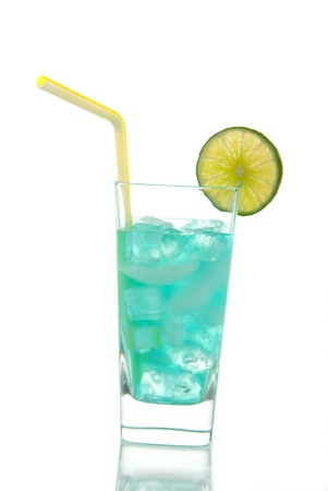 Miami Beach Iced Tea Cocktail with vodka, light rum, gin, tequila, blue curacao, lime juice, lemonade, lime wheel and straw isolated on a white background photo