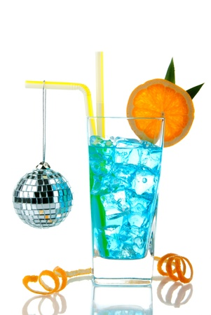 Blue Hawaii cocktail with malibu rum, blue curacao, pineapple juice, lime juice, orange wheel and disco sphere isolated on a white background Stock Photo - 8286408