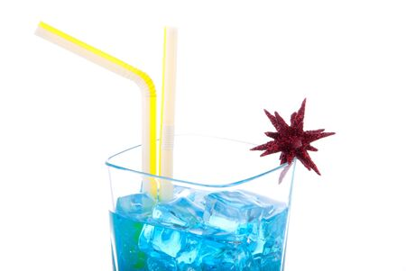 Blue Hawaiian Cocktails with vodka, light rum, gin, tequila, blue curacao, lime juice, lemonade, two yellow striped strawsand christmas star isolated on a white background photo
