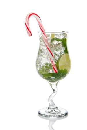 Mojito cocktail mint leaves, lime, simple sirup, light bacardi rum, club soda and christmas candy cane isolated on a white background 스톡 콘텐츠