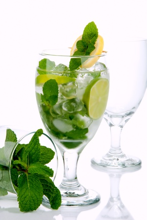 bacardi: Tropical Mojito summer cocktail with light  bacardi rum, fresh spearmint leaves, lime, club soda, simple syrup, sugar and crushed ice isolated on a white background Stock Photo