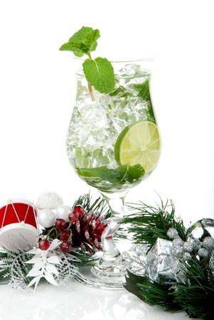 Classic Mojito cocktail with christmas ornament, mint leaves, lime, sirup, light bacardi rum, sprite soda and  isolated on a white background photo