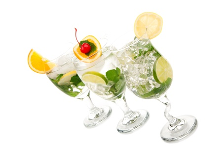 Tropical summer Mojito cocktail with mint leaves, lime, simple syrup, light bacardi rum, club soda, tequila, orange slice and maraschino cherry isolated on a white background photo
