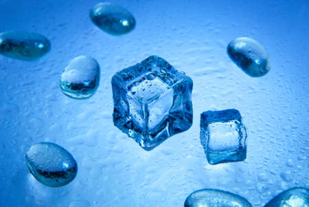 Ice cubes with  pure water drops  isolated on the blue background Stock Photo - 8373269