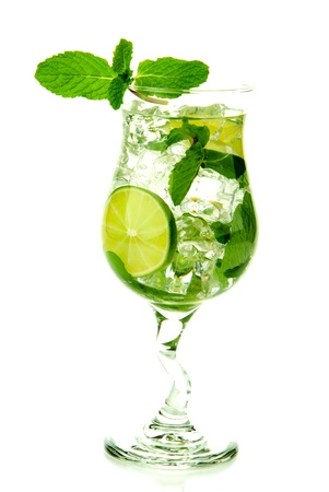 Classic Virgin Mojito summer drink without  alcohol with lime, spring of mint, soda and syrup in cocktail glass isolated on a white background Stock Photo