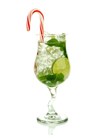 bacardi: Christmas Mojito cocktail with mint leaves, lime, simple sirup, light bacardi rum, club soda and candy cane isolated on a white background Stock Photo
