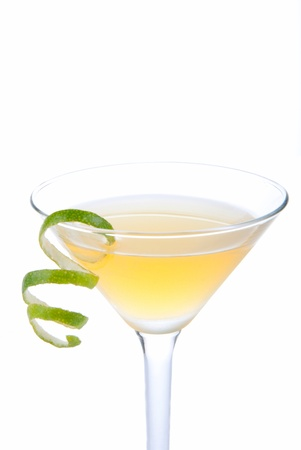 Azure Martini cocktail witn spiced rum, apple juice, amaretto, vanilla vodka and lime spiral isolated on a white background photo