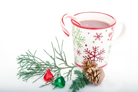Christmas and new year cup with cocoa, candy cane,fir and cones isolated on a white background photo
