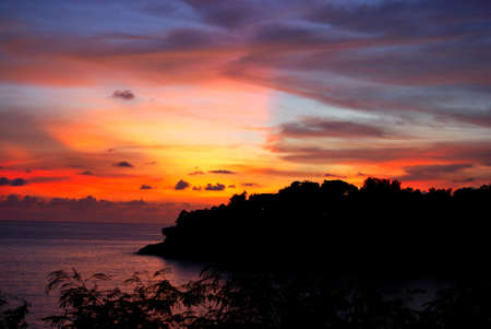 Sunset and Seascape in Patong beach south of Thailand Phuket in red, blue,orange and yellow background photo