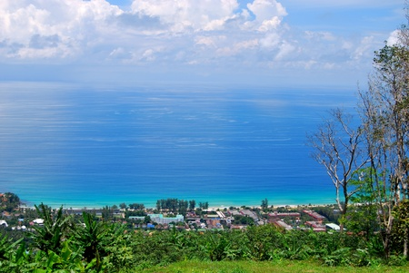 Beautiful beach view from mountainswith crystal clear blue waters and palm, banana trees on Phuket island