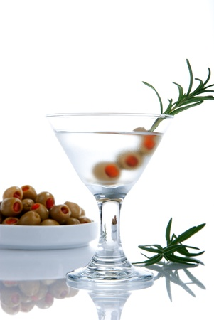 Classic Martini with vodka, three little green olives filled by red papper inside and rosemary composition isolated on a white background Stock Photo - 8408945