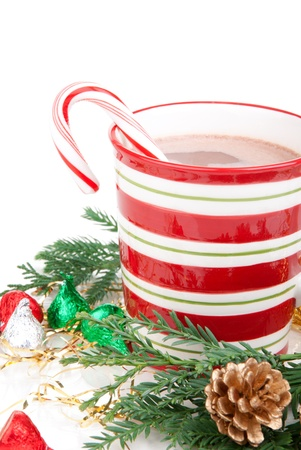 Christmas morning and new year mug with cocoa coffee, candies cane,fir and cones isolated on a white background