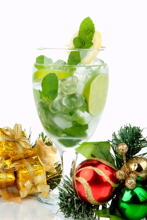 bacardi: Mojito Party Club Cocktail with mint leaves, vodka, lime, simple syrup, light bacardi rum, club soda and candy cane and christmas New Year ornament decoration  isolated on a white background