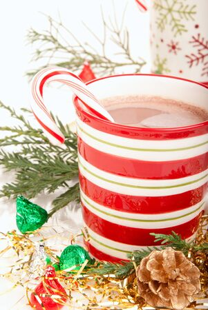 Christmas cups with Hot hot chocolate, tea, cocoa, candy cane decorated with fir branches and two pine cones, sweet candies isolated on a white background Stock Photo - 8445962
