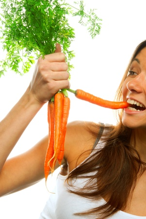 Young healthy woman holds in right hand bunch fresh orange organic carrots with green leaves from the garden isolated on a white background. Most popular image Stock Photo - 8521642