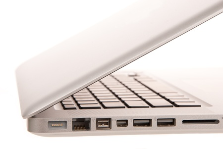 Side view of modern laptop computer with usb, MagSafe power, Gigabit Ethernet port, One FireWire 800, SD card slot isolated on white Stock Photo