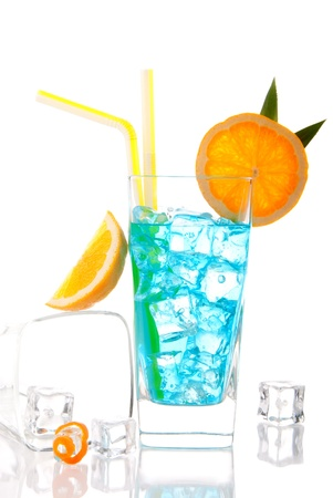 Blue Hawaiian Cocktail composition with ice cubes, vodka, light rum, gin, tequila, blue curacao, lime juice, lemonade, orange wheel  isolated on a white background photo