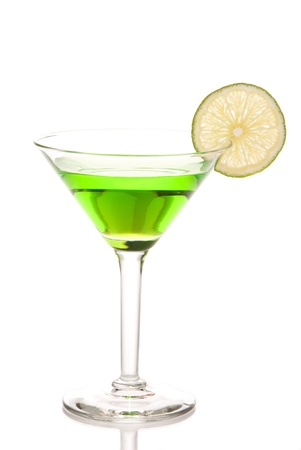 Green matrini cocktail with lime wheel, vodka, pineapple juice, liqueur in classic martiny cocktail glass isolated on white background
