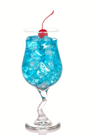 Blue Hawaiian Lagoon Cocktail with with malibu rum, blue curacao, vodka, tequila; pineapple juice, lime juice and red maraschino cherry on a white background