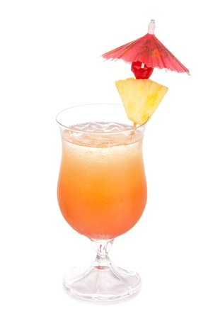 Tequila Sunrise cocktail with ice, triple sec, pineapple, cherry, cocktails umbrella, condensation isolated on a white background photo