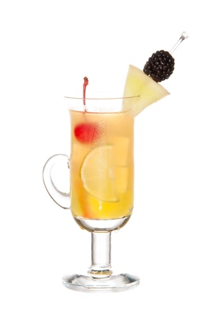 Fruity Mocktail drink with peach schnapps, apple juice, pineapple, maraschino cherry, lime, orange tea and blackberry in cocktail coffee glass isolated on a white background Stock Photo - 8703514