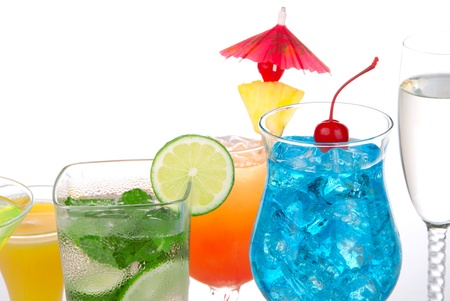 Popular cocktails with alcohol. Many different type of cocktail drinks. Blue hawaiian, Mojito; Mai tai, Martini, champagne glass, margarita garnished with lime, cherry, pineapple isolated on a white background photo