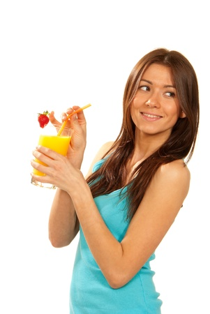 Healthy lifestyle brunette woman drink orange juice cocktail with strawberry with drinking straw isolated on a white background photo