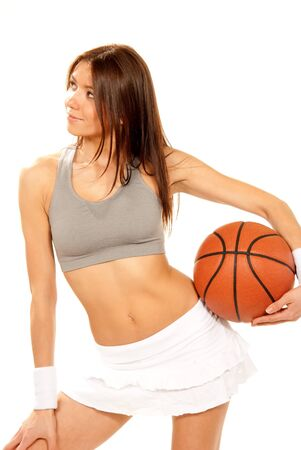 Sexy Basketball fitness brunette young woman player holding basketball in hand wearing skirt and top isolated on a white background Stock Photo - 8790899