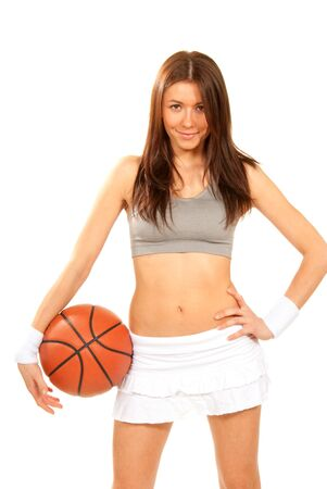 Basketball fitness brunette sexy young woman player holding basketball in hand wearing skirt and top isolated on a white background Stock Photo - 8790914