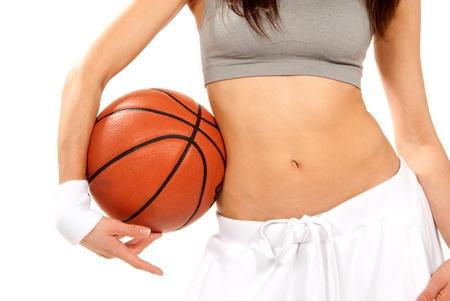 Woman body with basketball ball photo