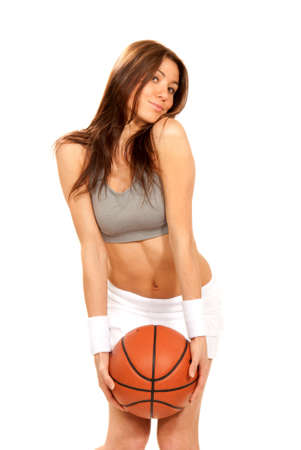 Basketball brunette cheerleader sexy young woman player holding basketball in hand wearing skirt and top isolated on a white background Stock Photo - 8790911