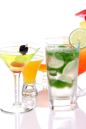 Popular cocktails with alcohol. Many different type of cocktail drinks. Mojito; Mai tai, Martini, Tequila sunrise, margarita garnished with lime, cherry, pineapple isolated on a white background