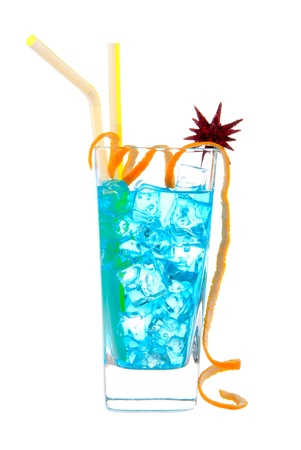 highball: Classic Blue Hawaiian Cocktail with vodka, light rum, gin, tequila, blue curacao, lime juice, lemonade, two yellow striped straws, twisted orange and christmas star isolated on a white background