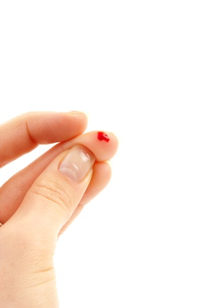 Flesh blood wound from diabetes patient finger to make glucose level blood test using ultra mini glucometer and small drop of blood  isolated on a white background