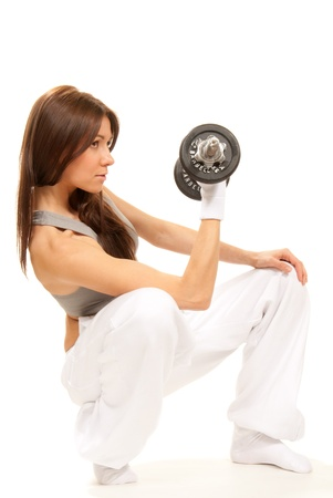 working woman: Fitness brunette woman instructor weightlifting with perfect athletic body and abs working out with weights dumbbells isolated on a white background