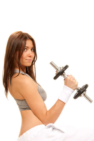 Fitness brunette woman instructor weightlifting with perfect athletic body and abs working out with weights dumbbells isolated on a white background Stock Photo - 8921887