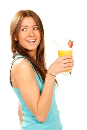Healthy lifestyle brunette woman drinking orange juice cocktail with strawberry with drinking straw in highball glass isolated on a white background photo