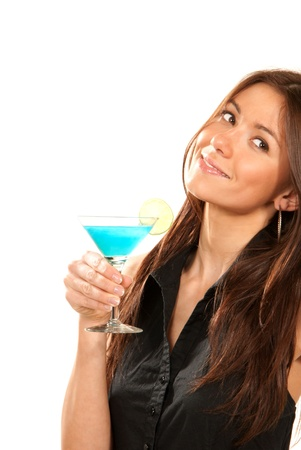 Pretty brunette woman lady holding popular blue tropical martini cocktail drink with lime in right hand in black shirt thinking and looking up isolated on a white background photo