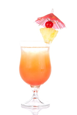 Tequila Sunrise cocktail with ice, triple sec, pineapple, cherry, cocktails umbrella, condensation isolated on a white background Фото со стока