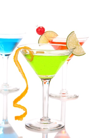 Tropical Martini Cocktails drinks green blue and red in back composition with vodka, light rum, gin, tequila, blue curacao, lime juice in classic martini cocktail glasses isolated on a white background Stock Photo - 8921904