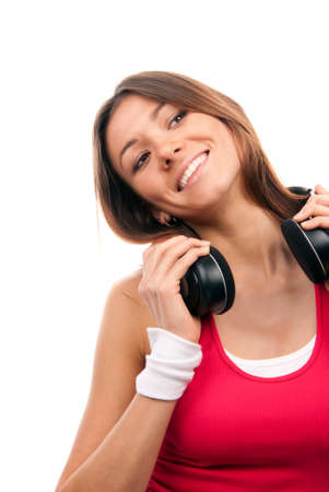 Sexy caucasian brunette woman listening and enjoying music in earphones headphones, smiling, laughing and looking away from camera isolated on a white background Stock Photo - 8921944