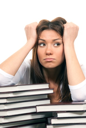 Female with books stack. Pretty brunette woman student being bored and tired of reading homework study assignment thinking of something else isolated on white background photo