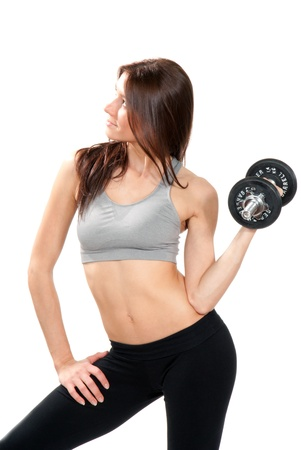 Pretty Fitness brunette woman gym instructor with athletic body working out and lifting weights dumbbells isolated on a white background  photo