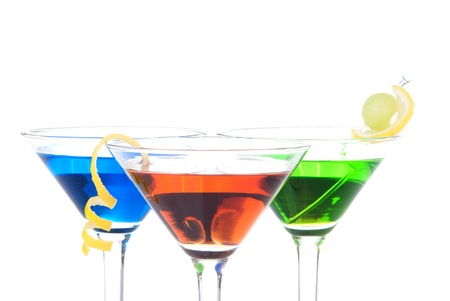 vermouth: Colorful Martini Cocktails drink blue green and red on top composition with vodka, light rum, gin, tequila, blue curacao, lime juice in classic cocktail glasses isolated on a white background Stock Photo