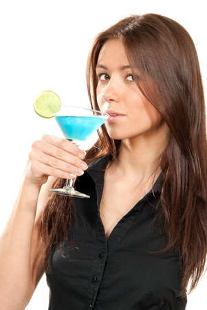 Woman drinking martini cocktail. Pretty brunette lady holding popular blue tropical martinis glass with lime in right hand in black shirt isolated on a white background Stock Photo - 8992052