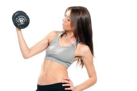Instructor de mujer atractiva gimnasio Morena en la dieta con cuerpo Atlético perfecto y abs elaborar con pesas Rosa pesos mini gimnasio aislado en un fondo blanco photo