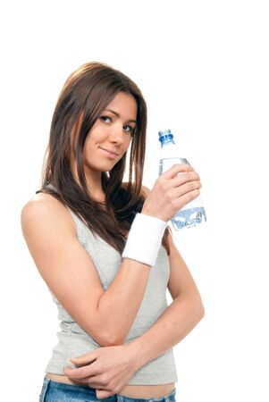 Girl hold bottle of pure still drinking water nutrition facts. Female holding in hand sparkling mineral bottled water isolated on a white background Stock Photo - 9125688