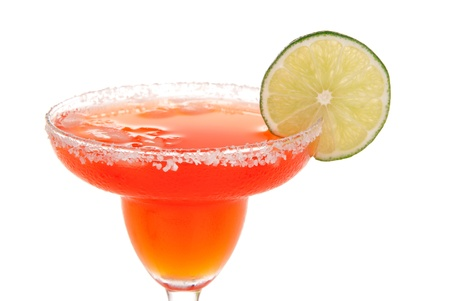 shot: Red strawberry margarita cocktail in chilled salt rimmed glass with tequila, liquor, juice and crushed ice garnished slice of fresh lime in margaritas cocktails glass isolated on white background Stock Photo