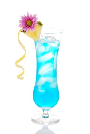 blue hawaiian drink: Blue hawaiian curacao cold cocktail decorated with pineapple, lemon twisted spiral and summer beautiful pink flower cocktails glass filled with ice isolated on a white background Stock Photo